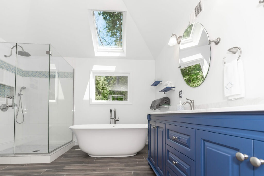 blue and white bathroom with shower, soaking tub, and vanity