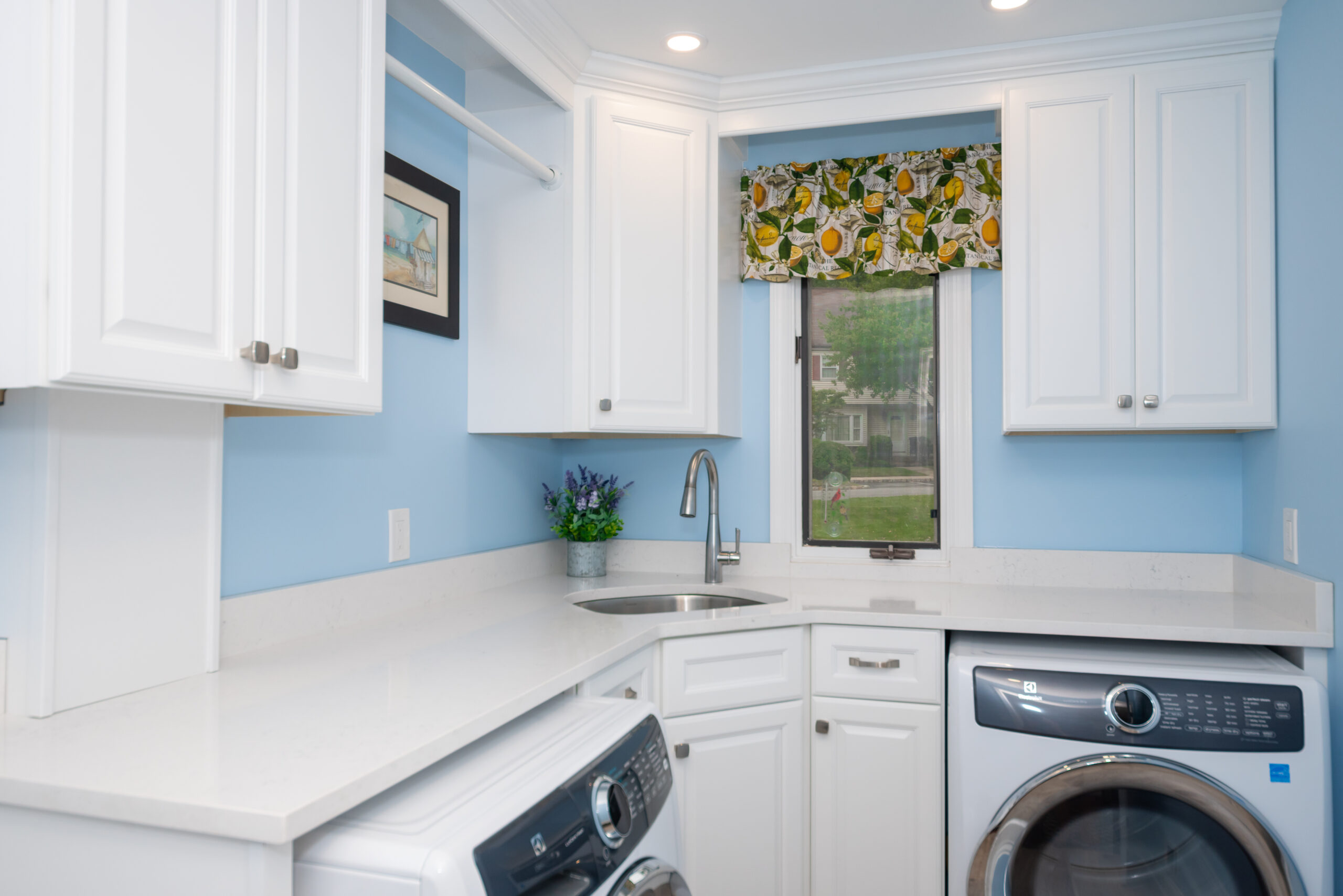 laundry room with appliances and sink