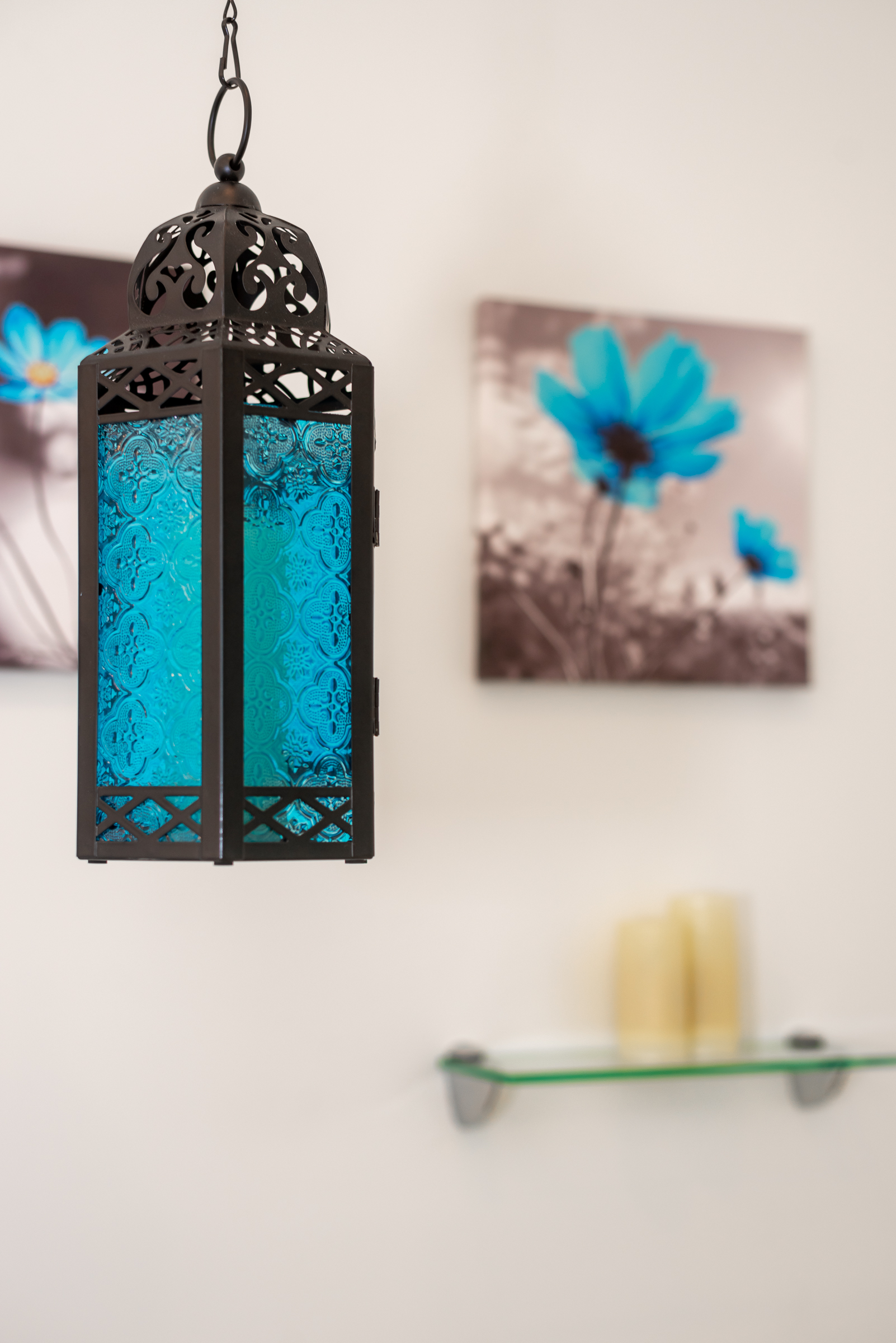blue glass and bronze light fixture