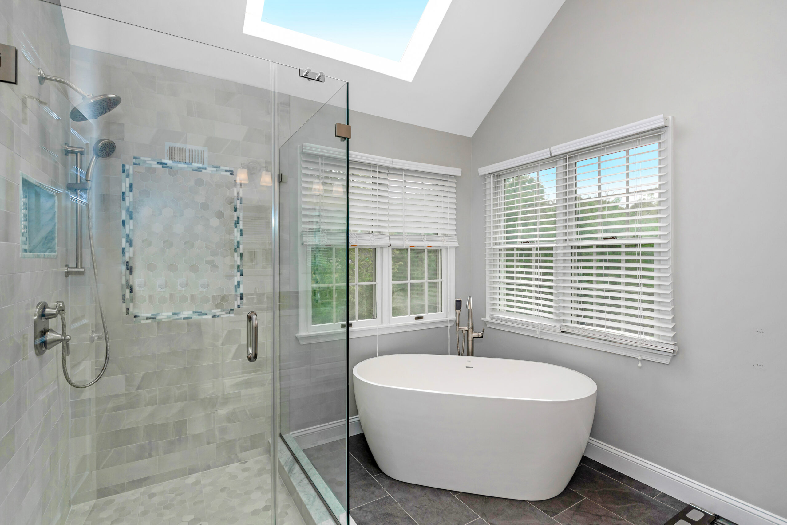 bathroom with soaking tub and glass shower