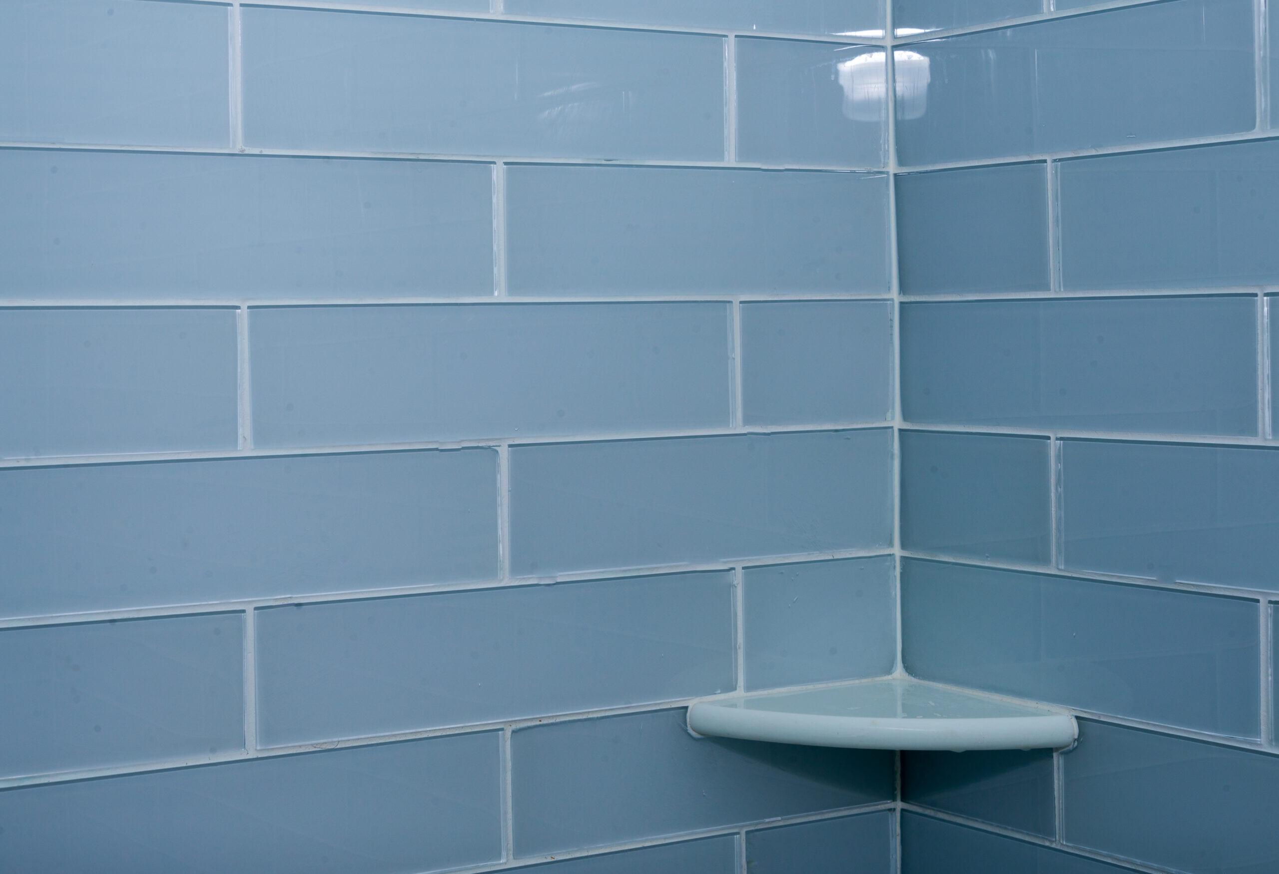 blue shower tile with corner shelf